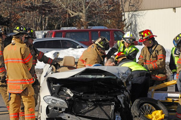 Fire and ambulance personnel work to extricate a driver that involved in the accident on County Raod 39 this afternoon.  DANA SHAW