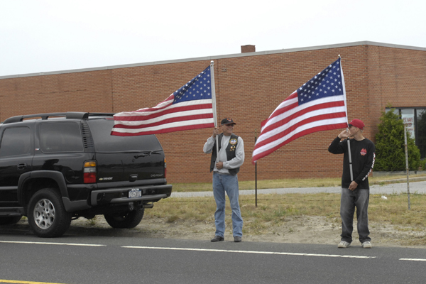 The motorcade in Westhampton after leaving Gabreski airport.<br></noscript>Photo by Dana Shaw