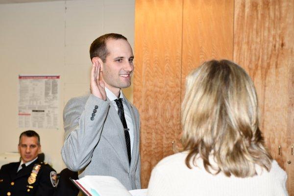Officer Ryan Miller is sworn in on Thursday.