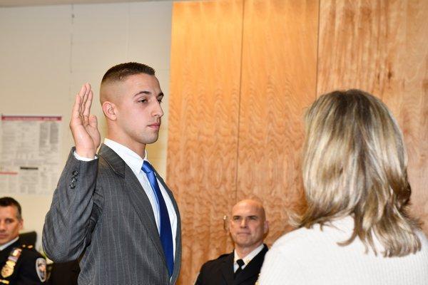 Officer Josiah Hoshyla is sworn in.