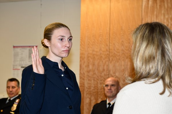 Officer Caryl Pfeiffer is sworn in.
