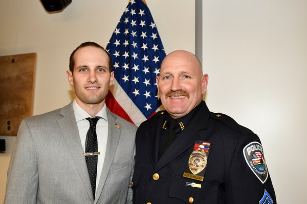 Officer Ryan Miller with his father Sergeant Steve Miller.