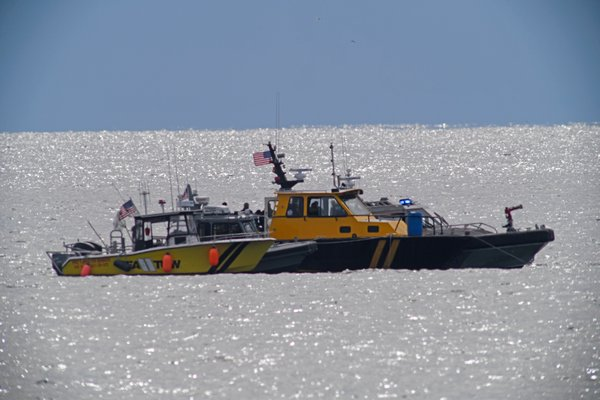 The seach for plane that crashed continues on Sunday in waters near the Surf Club in Quogue.  DANA SHAW