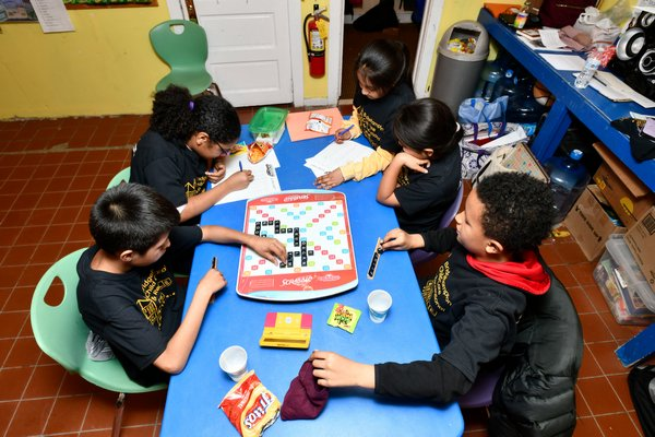 Members Bridgehampton Child Care & Recreational Center Scrabble team prepare for the North American School S