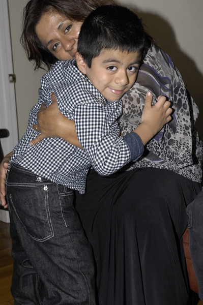 Patricia Vega and her son Ismael in their Hampton Bays home.   DANA SHAW