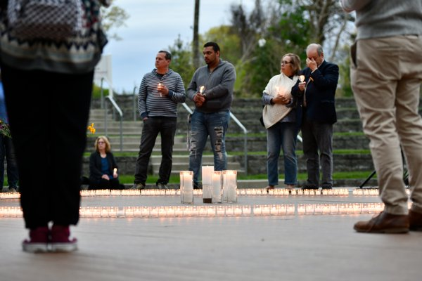 Friends and family member attended a candlelight vigil in good Ground Park on Saturday evening in remembrance of those killed in the opioid crisis.