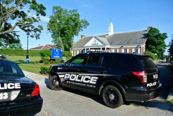 Southampton Town Police at the scene of a bank robbery at Chase Bank in Hampton Bays on Friday afternoon.  DANA SHAW