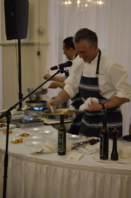 Chef Christian Mir of the Stone Creek Inn gives a presentation at the Taste of Tuckahoe event on Friday night. BY ERIN MCKINLEY