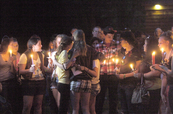 A candlelight vigil was held on the East Quogue Village Green on