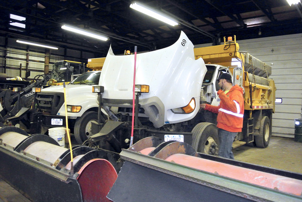 Southampton Town  Highway Department employee Ryan Jiudice gets his snowplow ready for the storm on Friday morning.  DANA SHAW