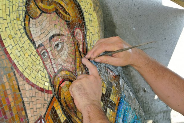 individual pieces of galss make up the mosaic.
