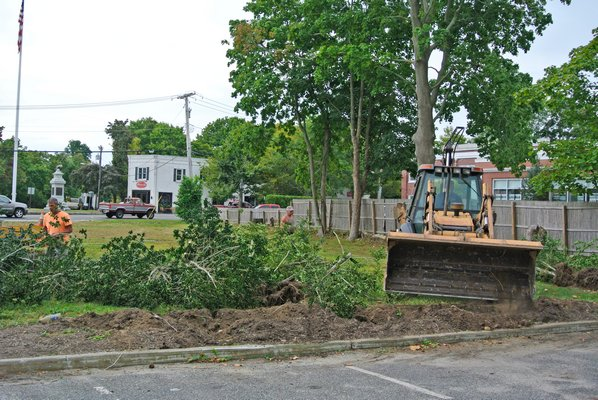 Crew began clearing brush at the proposed CVS site in Bridgehampton on Tuesday.  DANA SHAW