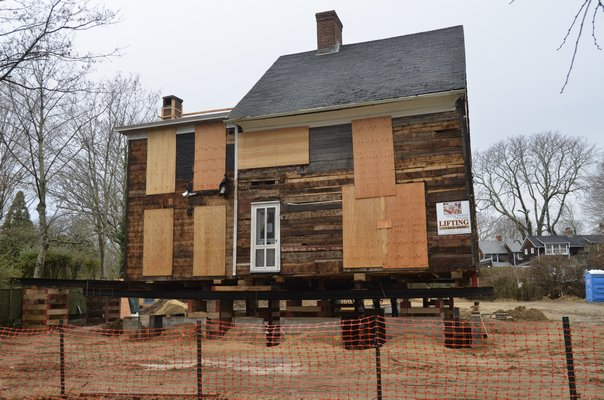 A private home on Main Street has been lifted in order to get a new foundation. SHAYE WEAVER