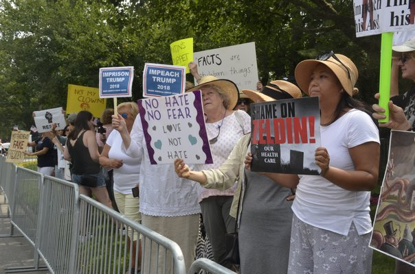 Numerous people came out to protest President Donald Trump's arriv