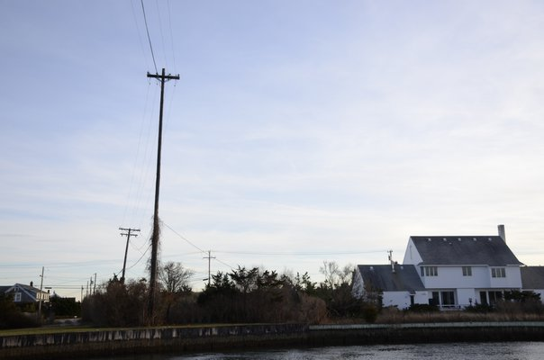 One of the circuits on the East End that is being upgraded by PSEG using federal money goes across the Quogue Canal in Quogue. BY GREG WEHNER