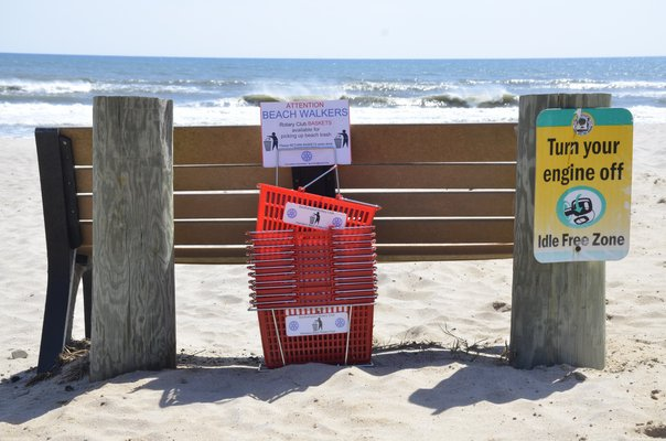 Tim Corwin and members of the Southampton Rotary Club placed baskets at Little Plains Beach in Southampton Village