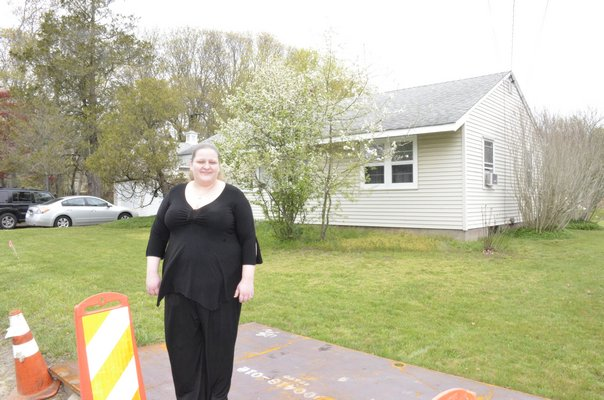 drilled a hole for one of those poles in Eastport resident Carolyn Ceruti's front yard