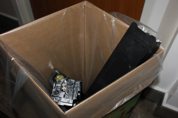 Southampton Town Employee Colleen Tuohy-Jones puts her old toner cartridge in the recycling box located at Southampton Town Hall. VALERIE GORDON