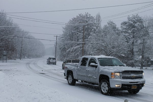 Cars drive on Old Riverhead Road in Hampton Bays on Monday afternoon. KYLE CAMPBELL