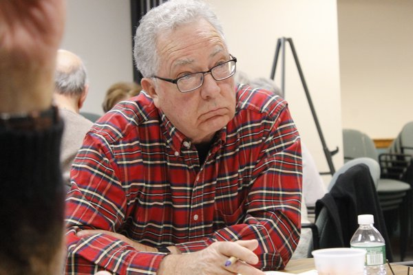 owner of Tuckahoe-based Sandpebble Builders leads a charrette on possible upgrades and improvements to the Hampton Bays Public Library on Saturday afternoon. KYLE CAMPBELL