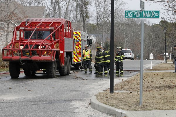 Volunteers from the Eastport and Center Moriches fire departments as well as the East Moriches Ambulance Corps responded to brushfires on Eastport-Manor Road in Eastport Wednesday afternoon. KYLE CAMPBELL
