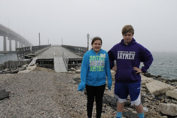 Mary Reister and David Reister stand by the old Ponquogue Bridge in Hampton Bays on Friday afternoon. KYLE CAMPBELL