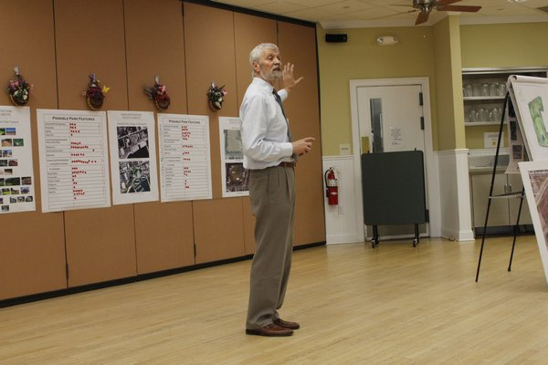 Southampton Town Deputy Supervisor Frank Zappone speaks to community members about ideas for the proposed Good Ground Park on Monday. BY CAROL MORAN