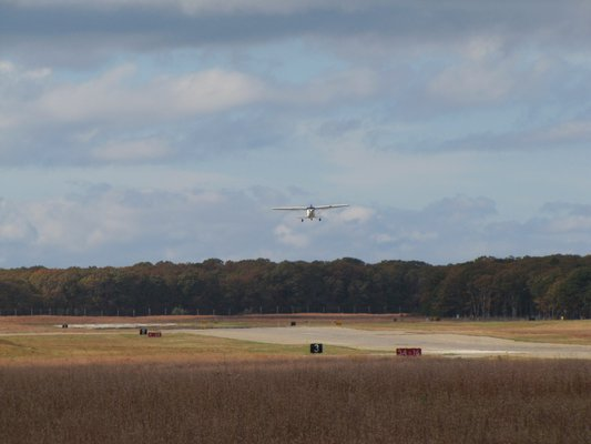 East Hampton Town has been criticized for plans to clear as much as 20 acres of woodlands to meet FAA safety standards for low-visibility landings at East Hampton Airport. MICHAEL WRIGHT