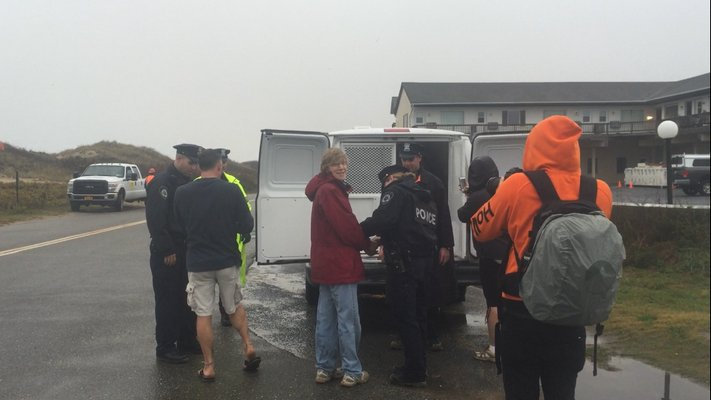 Several protesters were arrested by East Hampton Police Friday morning for forming a human chain to try to stop work on the Montauk shoreline project. MICHAEL WRIGHT