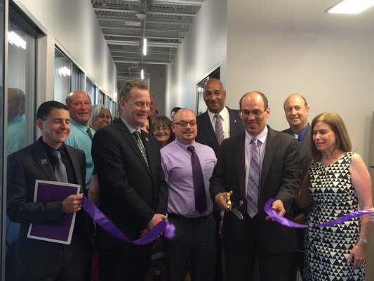 Members of the Alzheimer's Association Long Island chapter cut the ribbon on a new office in Riverhead. COURTESY ALZHEIMER'S ASSOCIATION