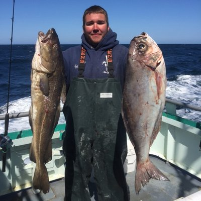 Tyler Quaresimo with nice specimens of a cod and barrelfish caught aboard the Viking Starship on a  deepwater wreck trips off Montauk late last month. Courtesy of the Viking Fleet
