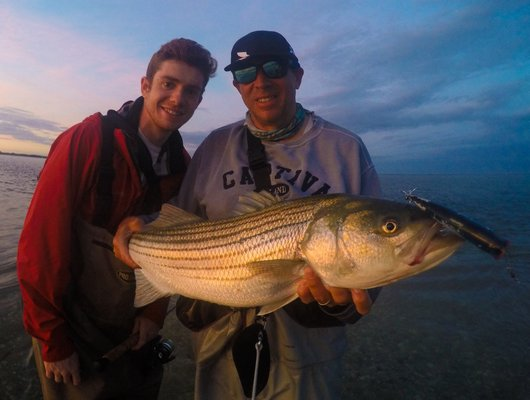with a nice Peconic Bay striped bass.