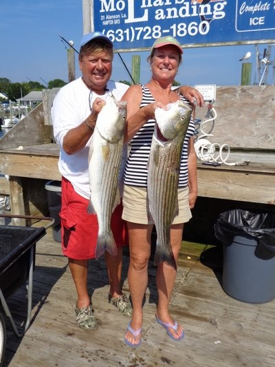 Marty and Helen Zoltowski with stripers caught in Shinnecock Bay aboard Aqua Mama.