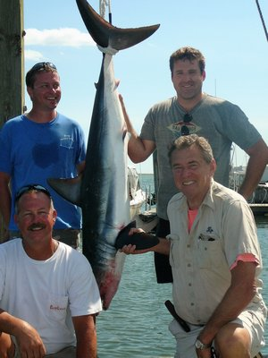 Kip Molnar and the crew of the Bahama Bro landed this 130 pound mako shark while fishing off Hampton Bays last week. Lanny Molnar