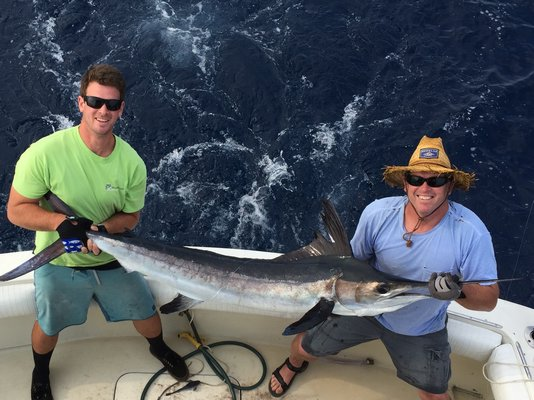 Jim Otto and Mike Briley display a nice white marlin (or is it a hatchet marlin?) they landed recently on an offshore trip. Mike Ferrara