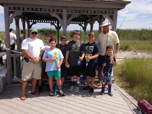 Winners of the Southampton Town snapper derby last weekend collected their prizes from Parks and Recreation Superintendent Chris Bean and Town Trustee Scott Horowitz.