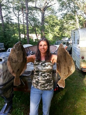 Ramona Gallo with a pair of big fluke she picked out of Western Shinnecock Bay this summer. Franbo
