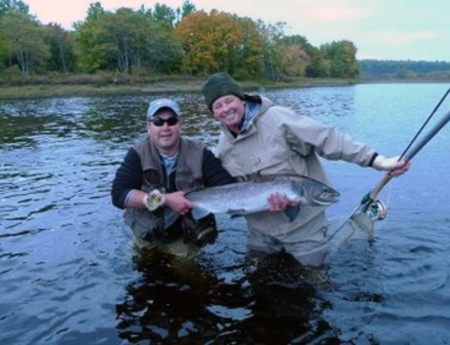 Benny Krupinski is understandably all smiles after catching this 30 pound Atlantic salmon while fly fishing in Canada last week.