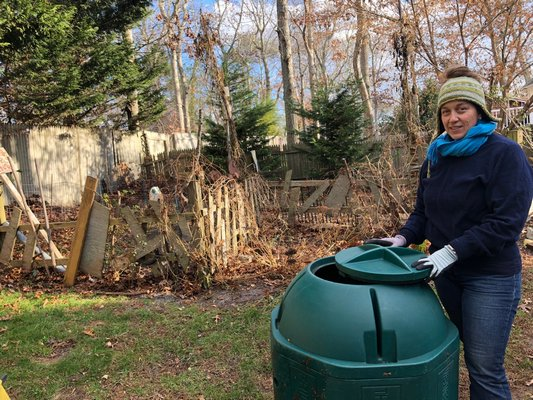 Carolyn Munaco of Hampton Bays is a diligent composter. Composting is a good way to reduce waste that is sent to landfills. CAILIN RILEY
