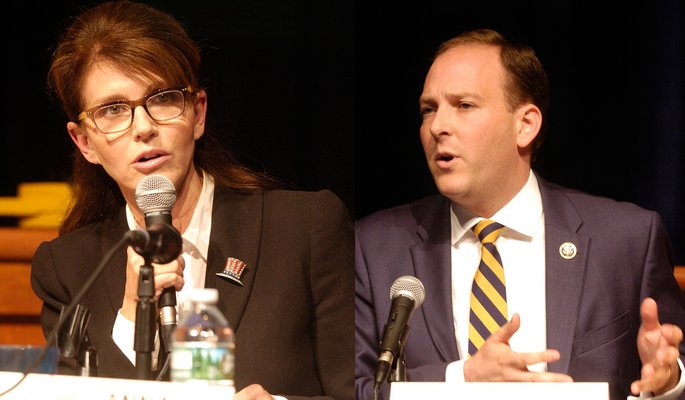 Anna Throne-Holst and Lee Zeldin debate at Westhampton Beach High School on Thursday night.  DANA SHAW