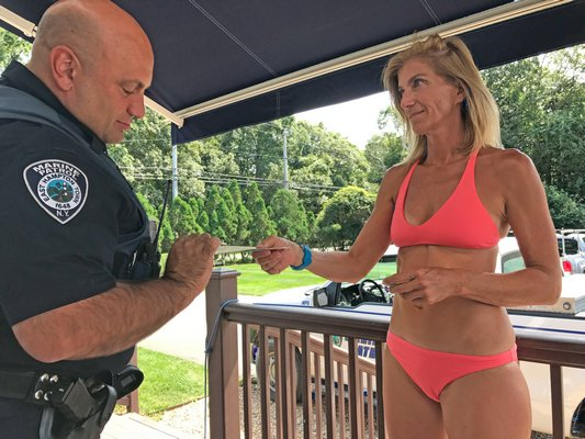 Paddle Diva owner Gina Bradley was issued yet another summons last week in her ongoing struggles with the town over her paddle board tours operating from Shagwong Marina on Three Mile Harbor.