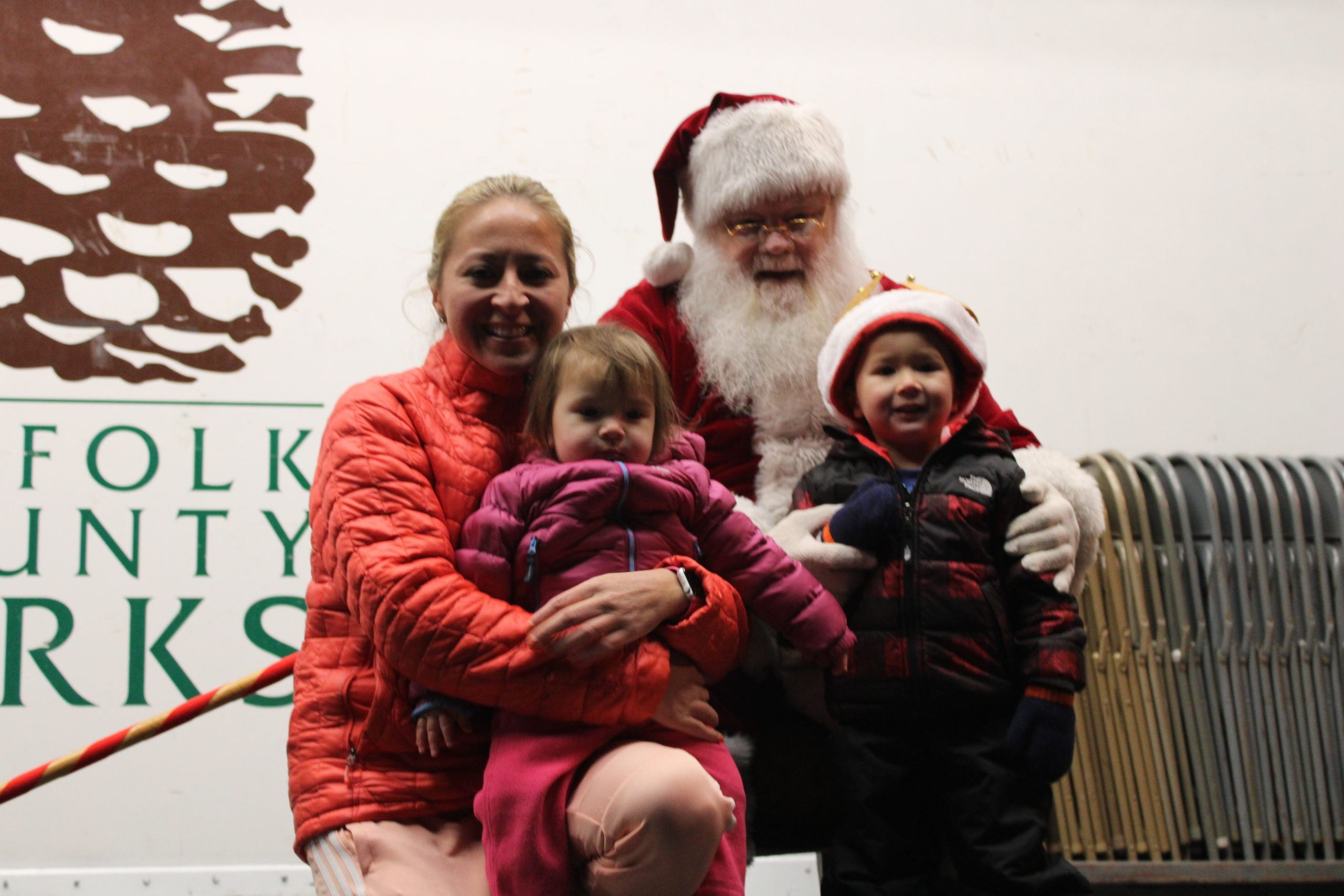 Viviana Smith and her children Bryce and Sofia metting Santa.