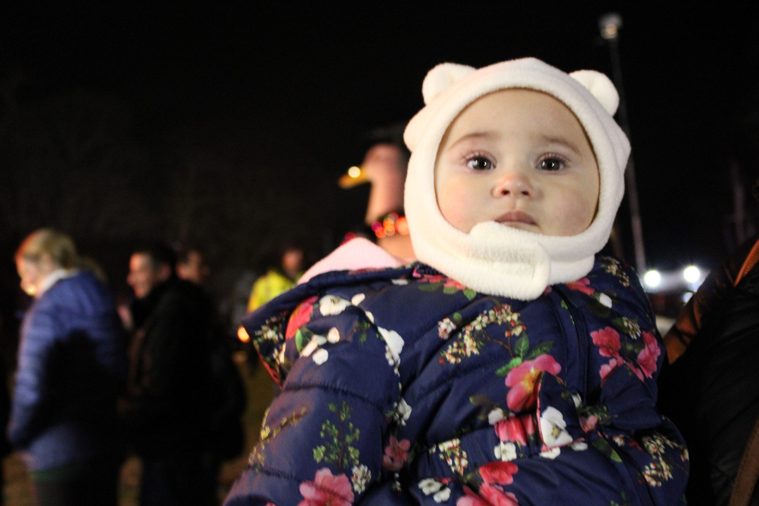 Eliana Valderrama watching Santa on stage.