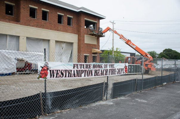 Construction crews work on the the new Westhampton Beach firehouse that is located on Sunset Avenue. GREG WEHNER