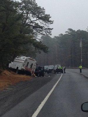 A PSEG Long Island truck crashed into a black SUV on Flanders Road on Thursday morning. CAROL MORAN