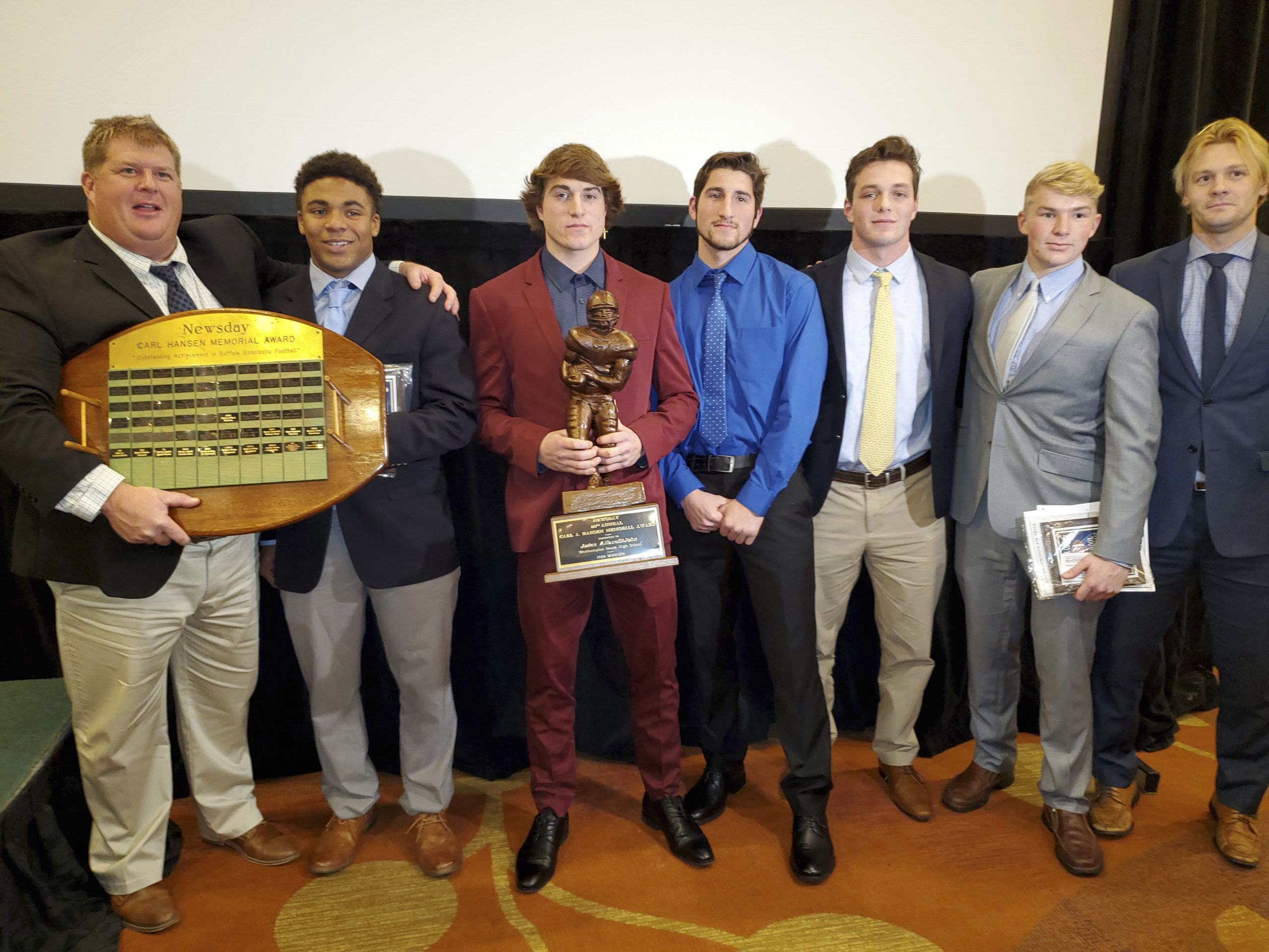 It was a big night for the Hurricanes at the Suffolk County Awards Dinner at the Hyatt Regency in Hauppauge on Monday night. From left to right, head coach Bryan Schaumloffel, Shavar Coffey, Jaden AlfanoStJohn, Jesse AlfanoStJohn, Chris Daleo, Devin Koonmen and assistant coach Cole Magner.