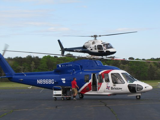Helicopters have been asked to split their approach and departure paths between north and south routes around East Hampton Airport to ease noise concerns.