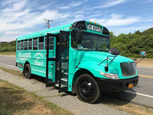 One of two Hampton Hopper buses offering transit to Montauk visitors and residents for free this summer. JON WINKLER