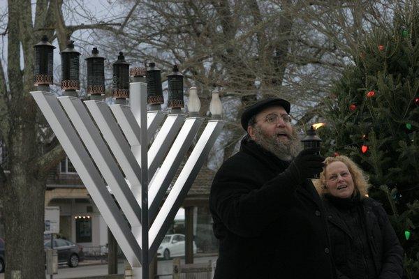 Rabbi Leibel Baumgarten at the lighting of the menorah in Herrick Park on Sunday. MICHAEL WRIGHT