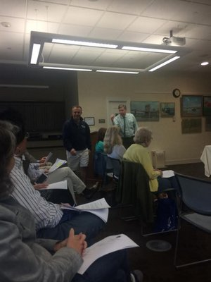Westhampton Library President Tom Moore tells a patron to sit down at the meeting last week. BY ERIN MCKINLEY